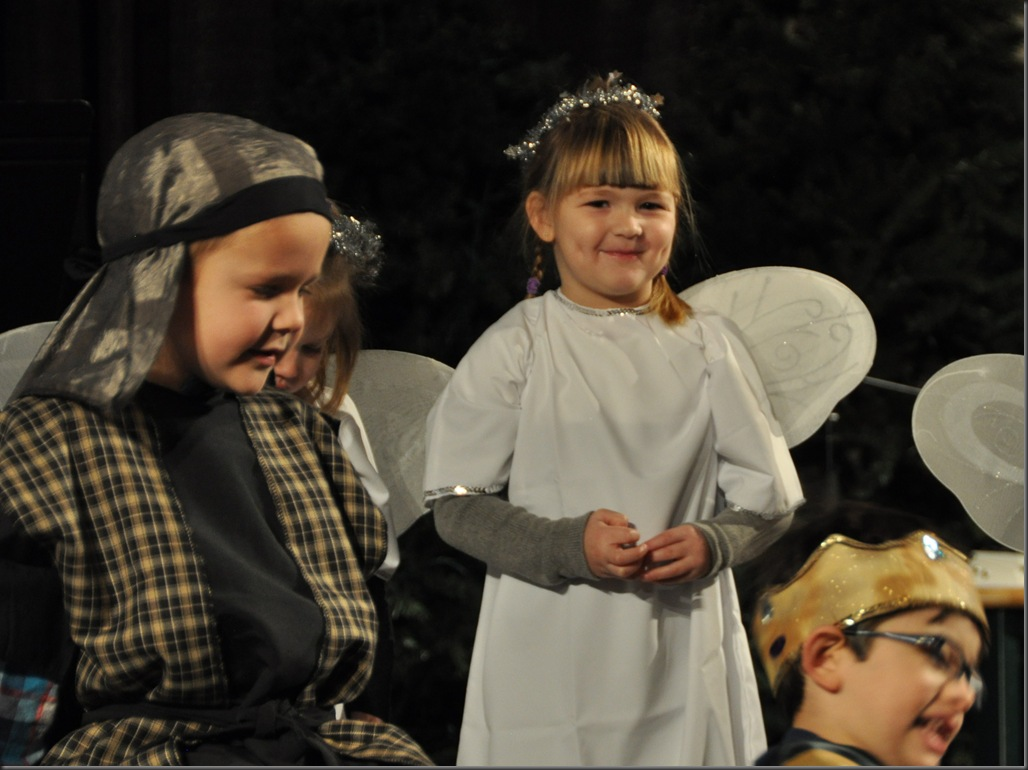 A little girl and boyd as an angel and a shepard at a christmas play