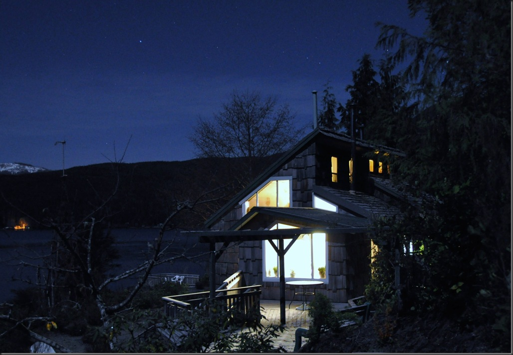 Our cabin at nightime, lit up with independent power and the stars.