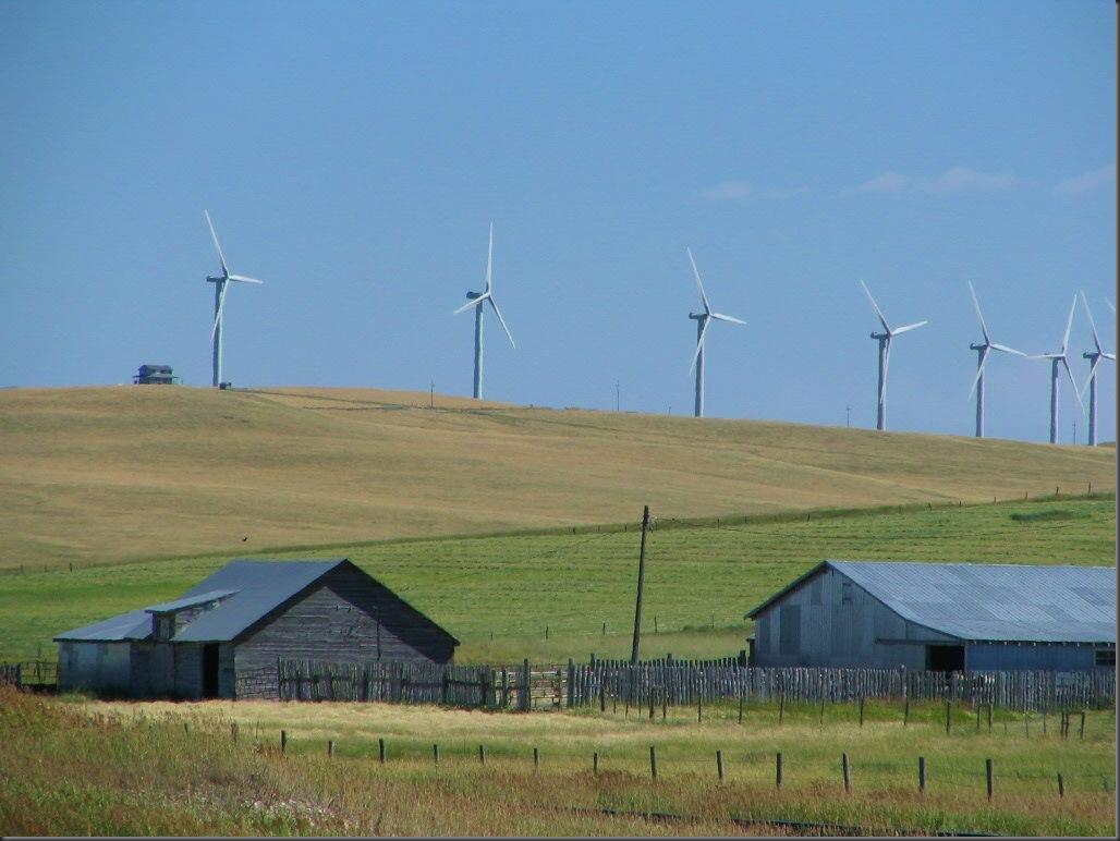 Wind farm and ranchers barns near Pnicher Creek, Alberta