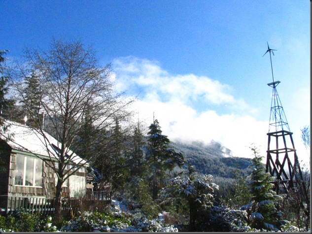 Small air 403 wind turbine and  solar home in the snow