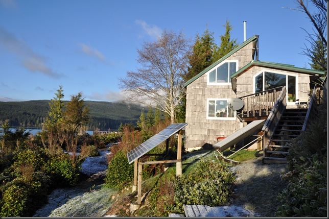 Our passive solar home with photovoltaic solar electric array and solar hot water tank