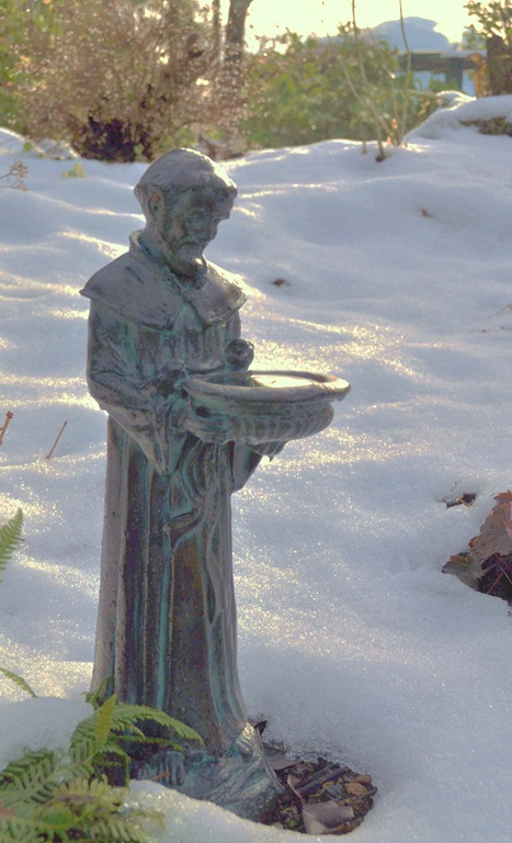 Statue of Saint Francis in the snow at the lake - bruce witzel photo