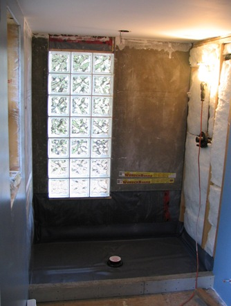 Building mexican style shower with glass block wall - by bruce witzel