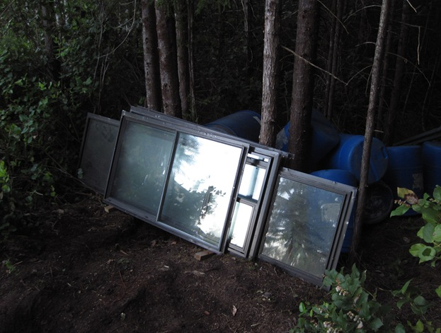 Recyled windows and 50 gallon drums waiting in the bush - bruce witzel photo