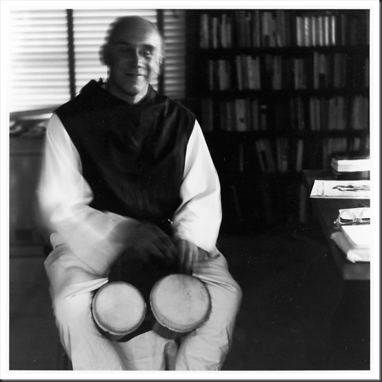 Thomas Merton playing bongos - photo by Ralph Eugene Meatyard