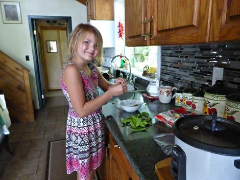 Emma on a stool shucking peas, July 2016 - francis guenette photo