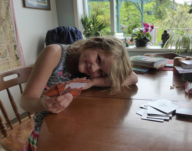 Emma playing cards at the lake - Francis Guenette photo