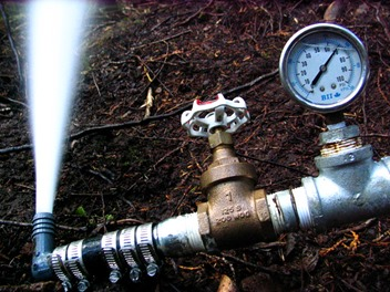 68 psi net pressure 145mm nozzle  = 79 GPM (calculate)  (nozzle is slightly larger than nine sixteenths of an inch)
