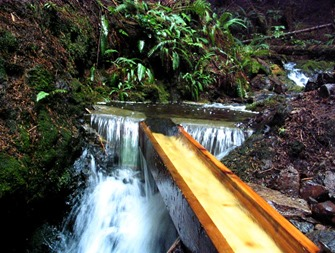 AFTER12 HRS RAIN - OCT. 21st - 4x7 inch flume is full - supplying probably 250 or 300 US gpm and stream still running full