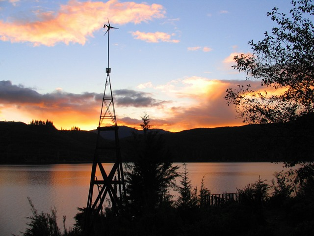 Our wind generator and lake sunset - bruce witzel photo