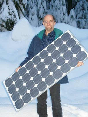 Pete Talbot of HomePower with a Siemens solar panel