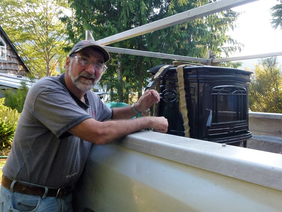 Bruce with new stove just arrived - francis geunette photo