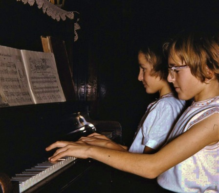 Heather and Rose playing a piano duet - aunt edith Fisher photo