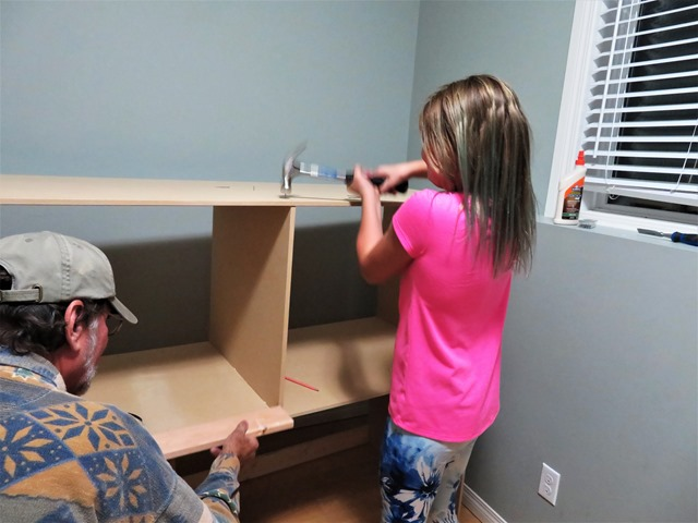 Emma nailing her doll house together - francis guenette photo