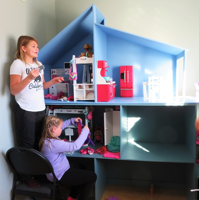 Finished doll house with Emma and Brit - bruce witzel photo
